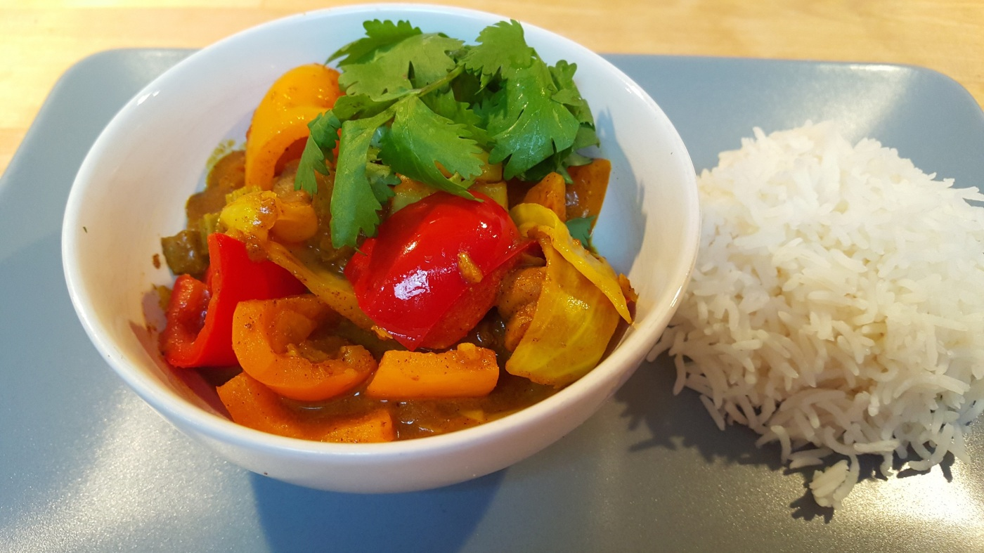 bowl of vegetarian curry and basmati rice
